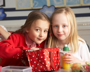 two girls eating lunch